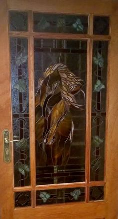Stained glass door with horse and ivy