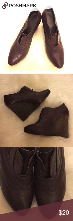 Joie wing tip oxford booties Joie booties. Wing tip details at the toe. Oxford slip in style. Wooden Wedge heels, about 4 inches. Size 37.5. I would say the color is deep plum, or brown. Joie Shoes Ankle Boots & Booties