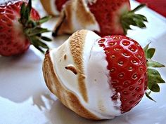 The newest camping dessert! Strawberries dipped in marshmallow fluff and then roasted over a campfire.