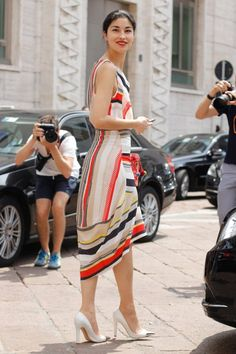 Pin for Later: 150+ Looks to Inspire Your Best Dressed Summer Yet  Caroline Issa is at it again in the coolest kind of striped dress and metallic toe-cap heels.
