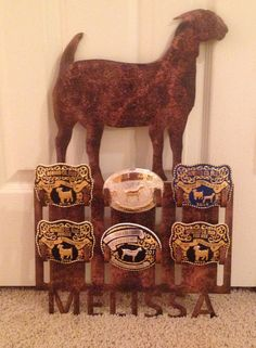 Show off those prized belt buckles with a stylish decorative personalized display rack. This listing is for a 6 buckle display. Holder measures approximately 19 tall and 14 wide and is cut from 14 gauge steel then primed and painted or available with a metal patina that will not scratch or chip. Available in your choice of the following animals: pig, boer doe, boer wether, boer buck, La Mancha, Nubian, alpine, steer, heifer, bull, lamb, rabbit, chicken, horse. In the notes to seller please li... Belt Buckle Display, Belt Buckles, Metal Projects, Projects To Try, Welding Projects, Tack Box, Show Goats, Ribbon Display, Award Display