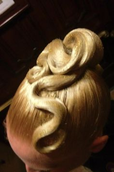 Ballroom hair with a few swirls, no stones (yet). Mainly used for Standard but can be done for both Standard and Latin. Visit http://ballroomguide.com/comp/hair_make_up.html for more hair and makeup info