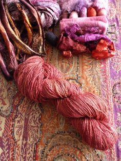 I've been experimenting with solar dyeing with natural dyes. I had this skein of tussah organic silk that was a kind of golden color. I dyed it with madder but it didn't do much except kind of stripe it here and there so I examined it and then redyed it with cochineal and a wee bit of lac from another left over jar. I loved the result, a strong red with subtle tones from all the different dyes. As usual, no idea what I'll do with it but it might be nice woven into something or knit.