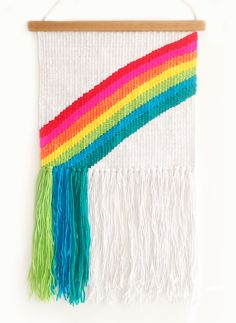 OVER the RAINBOW ♥ 'Rainbow' has been handwoven (by me) in gorgeous vibrant lovely yarns ♥ The colours are SO pretty and the texture is just gorgeous. Ready to ship straight to your door :) WE SHIP ANYWHERE IN THE WORLD! -------------------------------------------------------------- 59 cm from top of rod to bottom of tassels Actual weaving 31 cm wide (rod length 38cm)