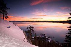 Sunset skiing over Lake Tahoe  Photo by Grant Kaye