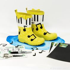 These adorable rain boots will leave you singing in the rain... we embellished regular rain boots using Duck Tape!