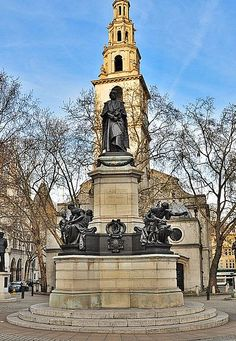 Gladstone Memorial to William E. Gladstone stands in The Strand, in front of St. Clement Danes. Unveiled 4.11.1905. Allegorical figures around the base represent Courage, Education, Aspiration + Brotherhood. Also represented are the arms of Gladstone's constituencies, Midlothian, Oxford University, the Duchy of Lancaster + Newark. Designed by Sir W.E. Thornycroft, the architect was J. Lee.