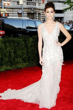 Emmy Rossum arrived at the Met Gala in a custom-made Donna Karan Atelier full-length white gown