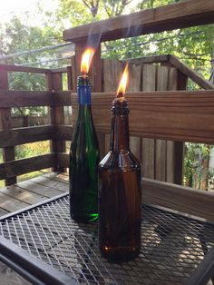 DIY Tiki Torch: wine bottle, pipe coupler, wick and tiki fuel. Easy!