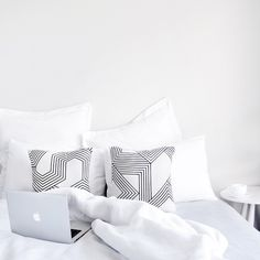 We love this all white bedroom with a hint of graphic decor.