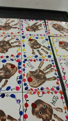 Parent presents - tile, acrylic paint handprint and thumbprints. Spray with lacquer