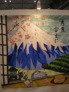 This quilt was made by 16 high school students - and maybe their teacher? As you can see Mt Fuji is popular with everyone, and cherry blossoms, and cats, and green tea ... Yokohama International Quilt Show