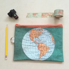 Oh, I love to travel the world!  Even better with this world map clutch.