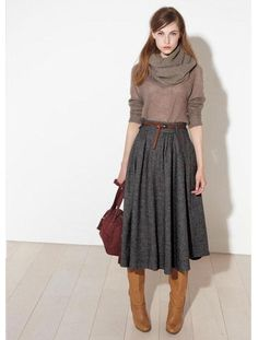 Long skirt, boots, fitted top with chunky neck or scarf