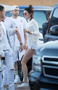 At a Fourth of July Party, Jenner opted for an all-white color palette in a long-sleeved lace top, cut-off shorts, and white sneakers. Stylish and practical, it seems like the way to go if you're going to live life on the edge in a stain-prone, monochrome look.
