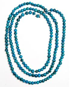This bold strand of acai seeds that can be worn as a double or triple strand is the perfect pop of turquoise your outfit needs.