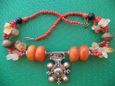 This is antique berber necklace with Ethnic Tribal Boghdad Southern Cross pendant , pre-owned by berber woman in southern of Morocco , used in