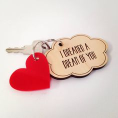 There can't be a more romantic way of hanging your keys than this...A dream cloud, cut and engraved to order from laminated birch wood with the wording 'I dreamed a dream of you' on one side. The reverse is waiting for any other words you'd like to add to the dream... remember where you met, or your significant date, or your soppiest thoughts. You think them, we'll engrave them (as long as they're not too rude!) To add EVEN more love to your keys, there is an acrylic heart charm attached to…