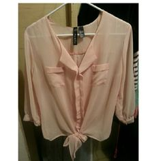 Spring Blouse Like new.Sheer blouse with tie in the front. Very airy and light weight. Perfect for spring. Only wore once. Tops Blouses