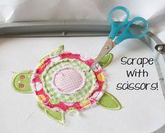 Cute raggy raw edge in-the-hoop flowers! . . . Oops, it's a turtle!