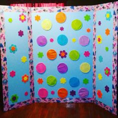 Trolls Pinata Board! Science board with a Trolls duct tape boarder, candy filled cups with tissue paper over them and decorated with stick on fabric flowers! Punch through and get your candy fix!