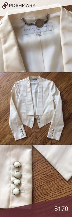 Stella McCartney ivory silk blazer Stella McCartney ivory cropped blazer with gorgeous lapels and buttons. Wear open or closed. 50% silk, 50% cotton blend making this jacket super chic and breathable. Looks great over dresses or with pants. Only worn a few times, in great condition! Italian size 42, made in Italy Stella McCartney Jackets & Coats Blazers