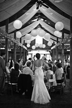 Twinkle lights, draped fabric, and paper lanterns as reception decor.