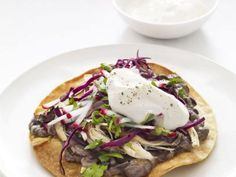 Get this all-star, easy-to-follow Chicken and Black Bean Tostadas recipe from Food Network Kitchen