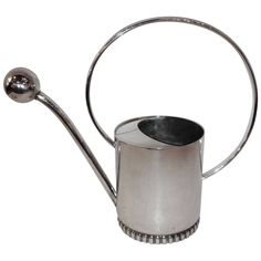 Art deco Danish Silver Watering Can | From a unique collection of antique and modern garden ornaments at https://www.1stdibs.com/furniture/building-garden/garden-ornaments/