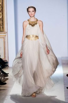 1. Zuhair Murad  Spring Summer Couture 2013; Looks like a Greek Goddess, high wasted, flowing white dress with pleats and draping and has some characteristics of an outer tunic..