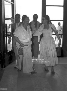 American gossip columnist Elsa Maxwell getting in the Excelsior hotel with Anna Magnani, Lido, Venice, 1948.