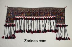 """Door Surround.  Interesting and unique wall decoration made from Afghan carpet and decorated with beautiful beads and dangling pom-poms. There are two holes at the far end corners, making it possible to hang on a wall or door. The geometric carpet pattern and amazing colors would look great in any home. Decorate your living room, dining room, or bedroom with this one of a kind wall decoration! Measurements: 42"""" W X 24"""" L. Product ID: 16DEC12AFGRUGDECOR http://www.zarinas.com/decor.shtml"""