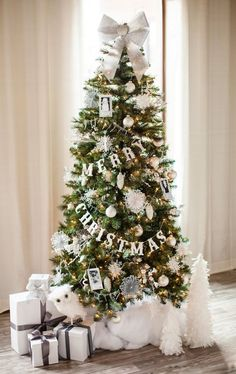 Holiday decorating & ideas - Christmas tree in simple style with white and silver ornaments and Merry Christmas garland.