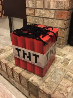 """Minecraft TNT Valentine Box #minecrafttnt #valentinebox #boysvalentinebox I had Office Max print the images found on Google. Then I used Mod Podge and a little tape to stick it to the box! Yarn was used for the wick on top. Pretty easy and a good """"kid helping"""" project!"""