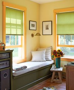 """""""A cozy book-nook by a window ... so you can watch the rain, read, color, or daydream."""" —Cynthia Ford    - CountryLiving.com"""