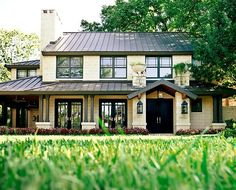 Contemporary Craftsman blends the modern lines of metal roof, etc, with some  traditional columns and porch elements.