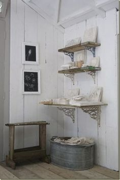 top of the stairs storage idea.... LOVE the big tub for dirty laundry!