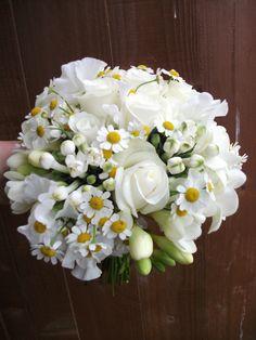 White lisianthus and camomile daisies with akito roses, freesia and bouvardia