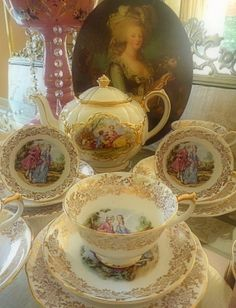 Let them eat cake! Vintage trios and mismatched teapot with Fragonard style designs of lovers.