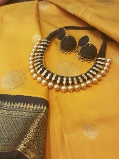 Truly a match made in heaven. A silver dipped in gold neck piece strung in black silk thread,and silk thread jhumkas. The saree itself is a woven wonder ,yellow with black kancheepuram Thread Jewellery, Temple Jewellery, Silk Thread Jhumkas, Jewelery, Silver Jewelry, Elegant Saree, Saree Dress, Sari, Neck Piece