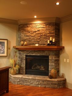 20 Appealing Corner Fireplace in the Living Room Tags: corner fireplace ideas modern, corner fireplace ideas in stone, corner fireplace decor, corner fireplace design ideas, fireplace ideas for corner Corner Stone Fireplace, Fireplace Redo, Fireplace Remodel, Living Room With Fireplace, Fireplace Surrounds, Fireplace Ideas, Corner Fireplaces, Fireplace Hearth, Simple Fireplace