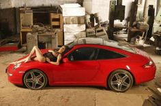 Sexy Girls lying Down with Symbols of Speed Cars Wallpapers