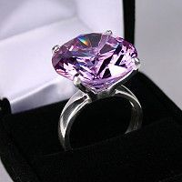 OH MY!! Purple diamond - There are only a few purple diamond rings that come to mind and the most famous might be the 8 carat purple diamond ring – worth over 4 million dollar - NBA star Kobe Bryant bought for his wife...