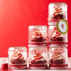 Swirled Cupcake Topper  Add a bit of red food coloring to your pastry bag before filling it with white frosting, then pipe on your cupcake of choice for a swirled peppermint look. Package cupcakes individually in Mason jars or festive boxes, then wrap them in ribbons and bows before sending along with holiday party guests.