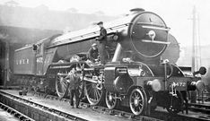 LNER A1 and A3 Gresley Pacifics: Driver Sparshatt standing infront of Gresley A1 Pacific No. 4472 'Flying Scotsman' at Kings Cross