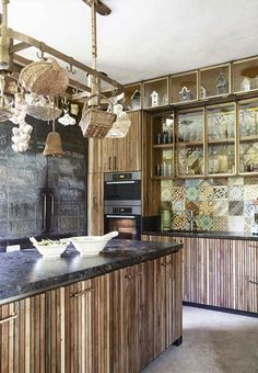 The interior of the house in the south of France was invented by the designer Lionel Jado. In the carpentry shops located in the neighborhood, they assembled wooden slats, from which later the facades for the kitchen were made. Boat Interior, Kitchen Interior, Interior Design, Kitchen Dining, Kitchen Decor, Kitchen Cabinets, Patchwork Tiles, Wooden Slats, Commercial Design