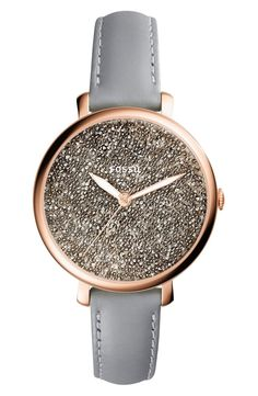A minimalist, numberless dial is encrusted with a bevy of shiny crystals and beads for glamorous caviar texture on this smooth polished watch with a svelte leather strap.