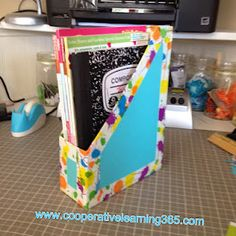 magazine holders from cereal box, scrapbook paper, and duck tap