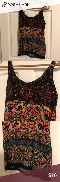 DetAiled Tank Top DetAiled tank top in excellent condition. Size large. Purchased from a boutique. One of a kind detailing with unique pattern. Angie Tops