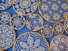 doilies displayed on embroidery hoops